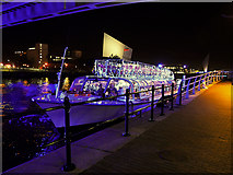 SJ8097 : Illuminated Boat at Salford Quays Central Wharf by David Dixon