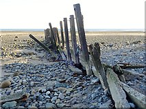 J3731 : Wave damaged groyne at the mouth of the Shimna River by Eric Jones