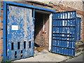 SO8218 : Doors to labour by Martin Richard Phelan