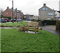 SO8103 : Wooden bench on the green at the edge of High Street, King's Stanley by Jaggery