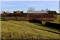 SE2491 : West Farm Outbuildings, Langthorne by Chris Heaton