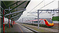 SP5175 : Rugby station, with Up Virgin Pendolino  express passing, 2006 by Ben Brooksbank