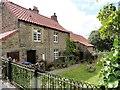 NZ0952 : Old cottages on Benfieldside Road by Robert Graham