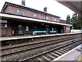 SO3013 : Turquoise benches on Abergavenny railway station by Jaggery