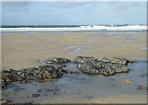 SW3526 : Rocks exposed on the beach at Sennen by Rod Allday