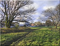 TQ2255 : Walton on the Hill: view towards the 'Blue Ball', from the heath by Stefan Czapski
