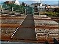 SH5800 : Tywyn railway station level crossing by Jaggery