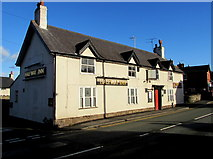 SJ3057 : Wrexham Lager sold here,  42 High Street, Caergwrle, Flintshire by Jaggery