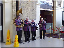 TQ2878 : Musicians at Victoria Station, London by pam fray