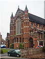 TQ2592 : West front, Church of St Barnabas, Woodside Park by Julian Osley