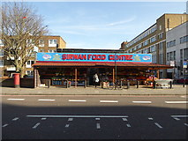 TQ3385 : Street scene on Stoke Newington Road at the Sirwan Food Centre by Jeremy Bolwell