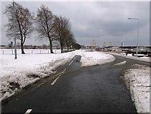 NT3699 : Snowy road in Methil by Bill Kasman