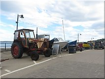 TA1280 : Tractor and boats, Coble Landing, Filey by Graham Robson