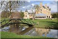 SP2852 : Bridge and lake and Walton Hall by Philip Halling