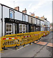 SO3700 : Yellow barriers in front of the Mad Platter, Bridge Street, Usk by Jaggery