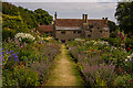SZ4083 : The Double Herbaceous Border, Mottistone Gardens by Ian Capper