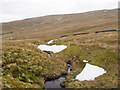 NY6344 : Snow patches along course of Longtongue Beck by Trevor Littlewood
