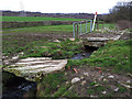 SE1540 : Footbridge over a stream below Low Springs Farm by Stephen Craven