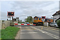 TL6169 : A container train at Fordham Level Crossing by John Sutton