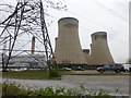 SE6627 : Electricity pylon and cooling towers at Drax Power Station by Graham Hogg