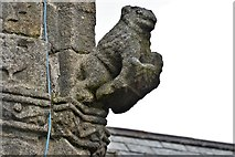 SX3384 : Launceston, St. Mary Magdalene's Church: Weathered sculpture on the tower by Michael Garlick