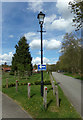 TM2241 : Lamppost & roadsign at Seven Hills Crematorium by Adrian Cable