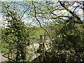 NZ1014 : Whorlton Bridge and Toll House seen through the trees by Jonathan Thacker