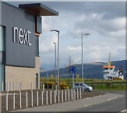 NS3174 : Ship passing Port Glasgow retail park by Thomas Nugent