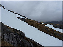 NM8999 : Remains of the winter's snow on Bac na Cloiche by Richard Law
