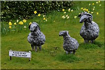 SO3958 : Pembridge, St. Mary the Virgin Churchyard: Sculptured sheep by Michael Garlick