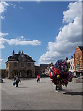 TL1998 : Balloon seller on Cathedral Square, Peterborough by Paul Bryan