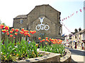 SE1565 : Pateley Bridge High Street with TdY bicycle (2018) by Stephen Craven