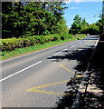 SO1723 : Zigzag yellow markings on the A479 near the former village school, Cwmdu, Powys  by Jaggery