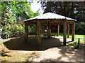 SJ7481 : Tatton Park gardens - African Hut with temporary roof by Stephen Craven