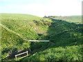 TA0294 : The coast path crossing Hun Dale, Cloughton by Humphrey Bolton