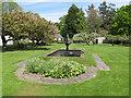 NT3235 : Traquair garden, fountain, apple trees by David Hawgood