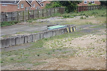 TM1542 : Shopping Trolley Storage area on Waste Ground by Adrian Cable
