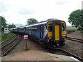 NN4257 : A train for Glasgow departing from Rannoch by John Lucas