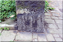 SE0724 : Benchmark on stone post at road junction on Darcey Hey Lane by Roger Templeman