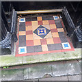 SX9372 : Tiled step, 18 Northumberland Place, Teignmouth by Robin Stott