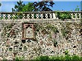 TG2208 : The Plantation Garden - Cosseyware in retaining wall by Evelyn Simak