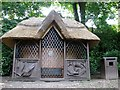 TG2208 : The Plantation Garden - thatched summerhouse by Evelyn Simak