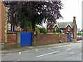 SK4937 : Boundary wall and lodges, St John's Primary School by Alan Murray-Rust