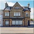 NH8399 : Fraser's Shop Golspie by valenta