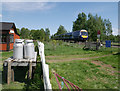 NN7399 : Train passing Aultlarie Halt by Craig Wallace