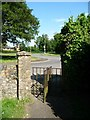 TL4195 : Turnstile exit from St Wendreda's churchyard, March by Christine Johnstone