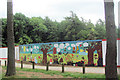 SP8808 : The Decorated Hoarding round the New Cafe Site in Wendover Woods by Chris Reynolds