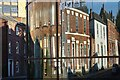 SE3221 : Houses reflected in college windows by Philip Halling