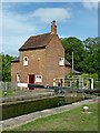 SP5465 : Cottage by Braunston Locks No 2, Northamptonshire by Roger  Kidd
