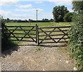 SO7704 : Wooden gates across a field entrance, Eastington by Jaggery